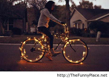 Awesome girl on a bike in fire
