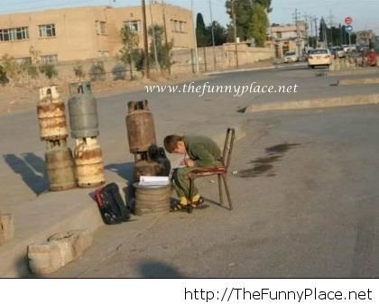 Iraqi boy sells gasoline to provide for his family