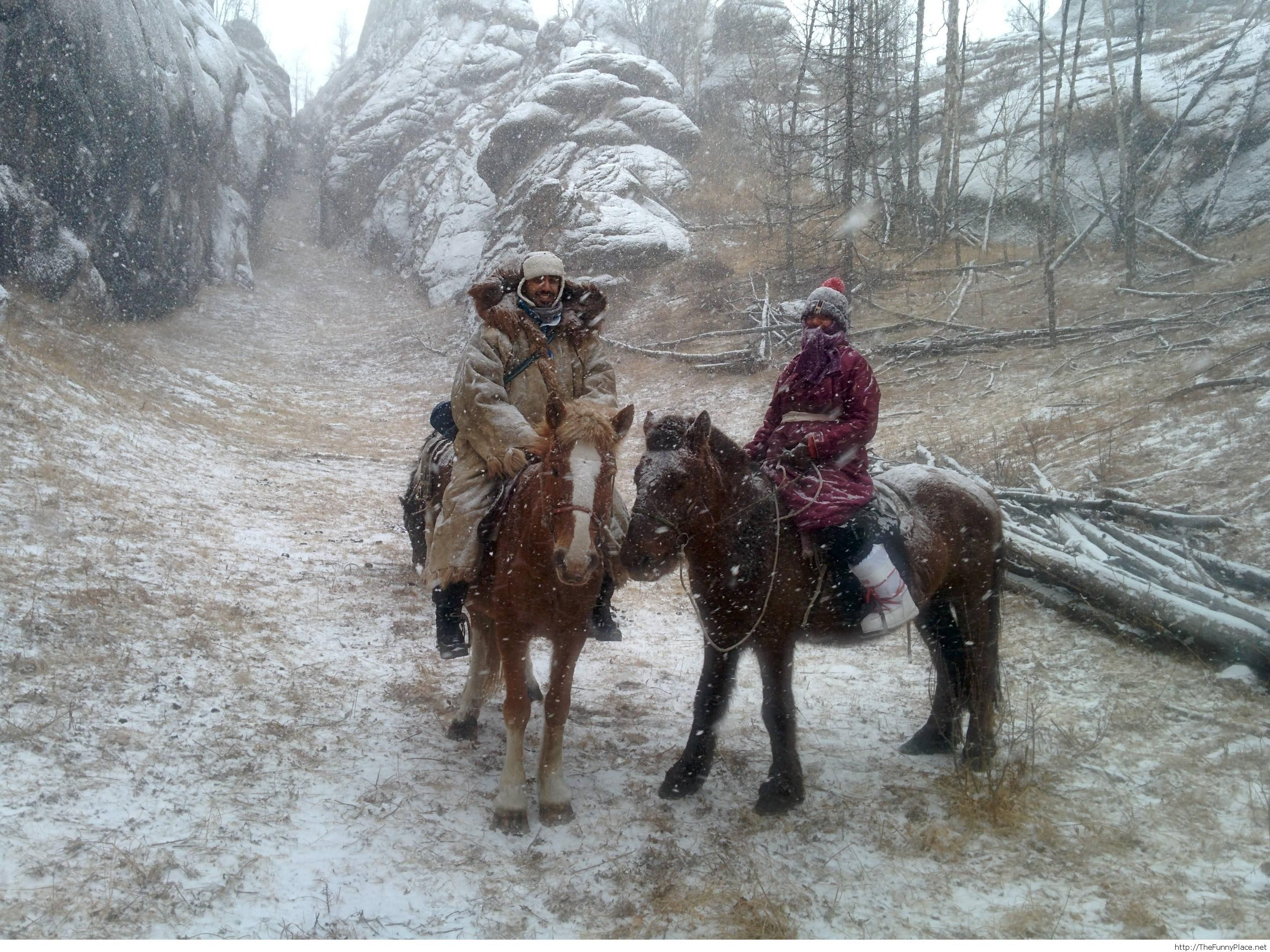 Horse riding in Mongolia's harsh winter. Took a wrong turn into Skyrim.