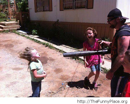Kid having fun with leaf blower